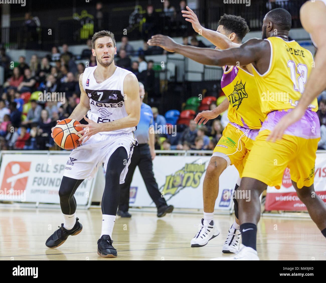 Copper Box Arena, London, 30th Mar 2018. Eagles Jure Gunjina (7) on the attack.Tensions run high in the British Basketball League (BBL) game between home team London Lions and the guests Newcastle Eagles. London Lions win 96-84. Credit: Imageplotter News and Sports/Alamy Live News - Stock Image