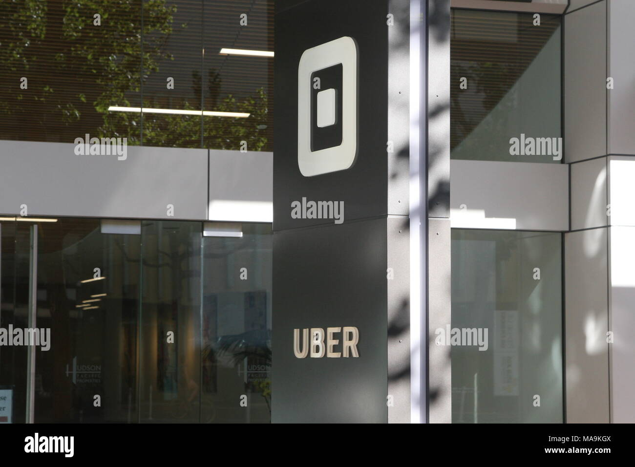 San Francisco, California, USA. 30th Mar, 2018. The worldwide headquarters of Uber Technologies Inc., located on Market Street in San Francisco, California. The family of a Elaine Herzberg, 49, killed in Arizona by an Uber autonomous vehicle has reached a settlement with the ride services company, ending a developing legal battle over the first fatality caused by a self-driving vehicle. The image shows signs, logos, and buildings on the Uber campus. Credit: Scott Carson/ZUMA Wire/Alamy Live News - Stock Image