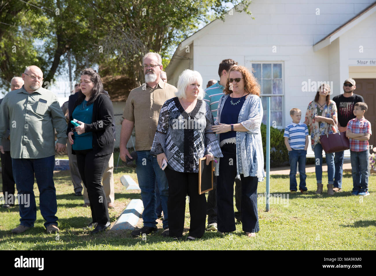 Survivors of the Sutherland Springs, TX, church shooting that claimed 26 lives in November 2017 listen outside the church as U.S. Sen. John Cornyn discusses his Fix NICS Act, signed into law on March 23rd. - Stock Image
