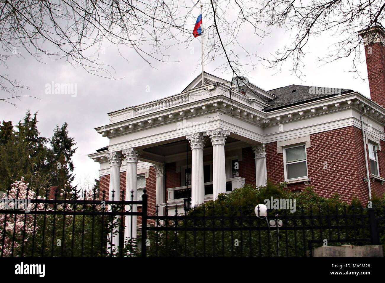 Seattle, USA. 30th Mar, 2018. The Russian flag flies over the Russian consular residence in Seattle. Earlier this week, the Trump administration ordered the closure of the Russian Consulate-General in Seattle by April 2. According to Russian officials, the residence of the Consul General will remain occupied until April 24 when, it too, must close. Credit: Toby Scott/Alamy Live News. - Stock Image