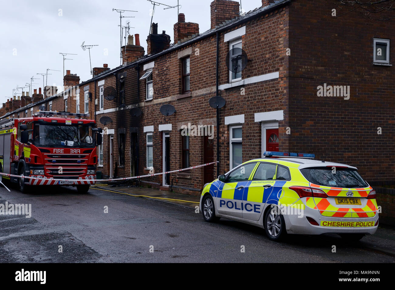 Phillip Street, Hoole, Chester, UK. 31st March 2018. A major house fire broke out at a terraced property last night with fire and police still in attendance this morning. Credit: Andrew Paterson/Alamy Live News - Stock Image