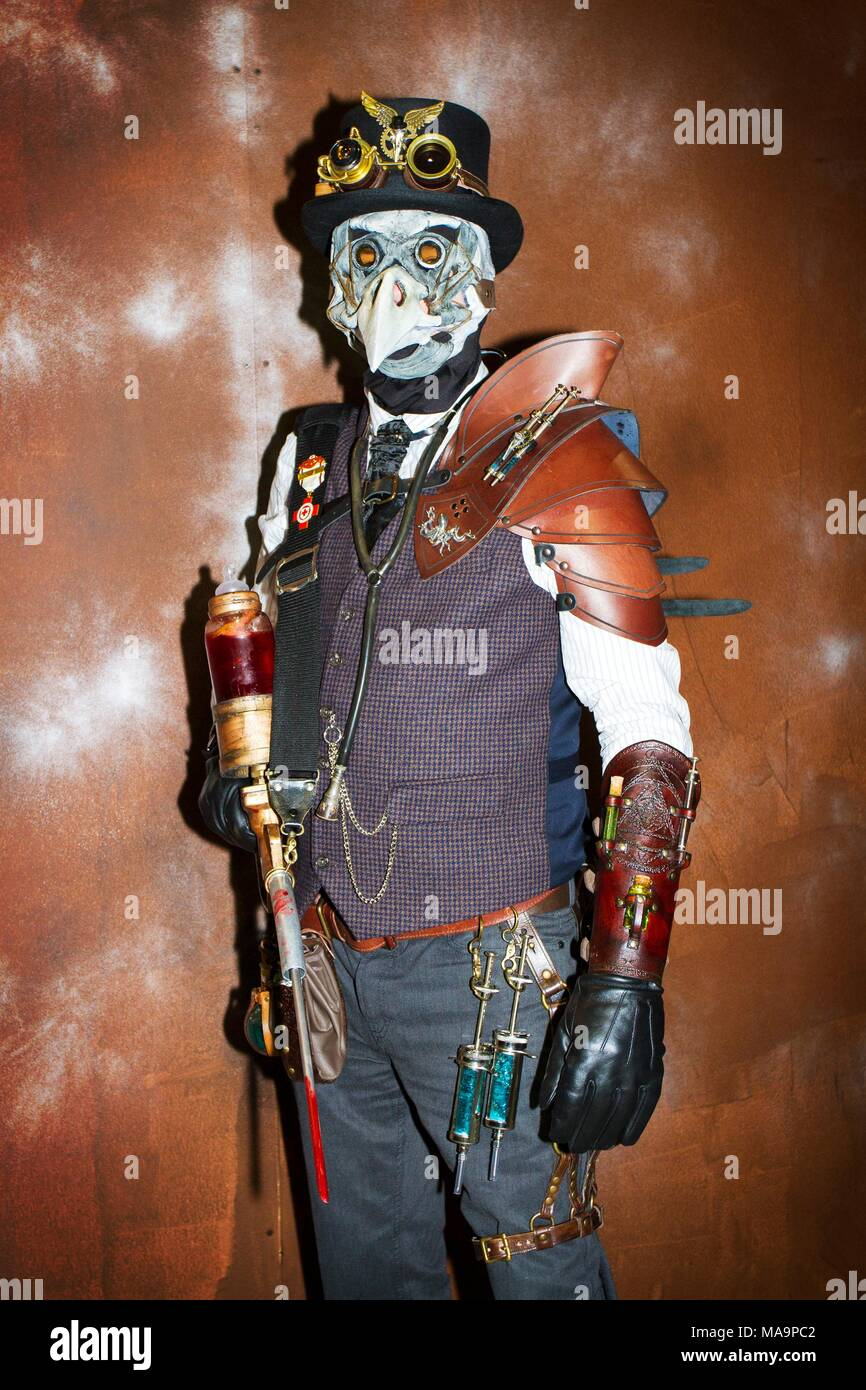 Manchester, UK, 31st March 2018.  Plague Doctor; Post apocalyptic time travellers meet up for a weekend at the asylum as the four day steampunk convention gets under way at the Bowlers Exhibition Centre in Greater Manchester.  Credit: Cernan Elias/Alamy Live News - Stock Image