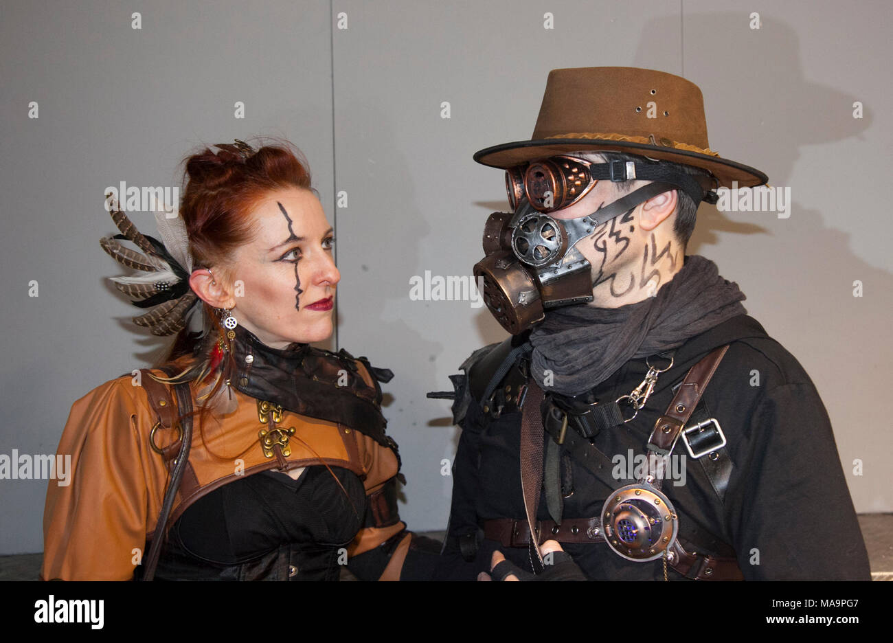Manchester, UK, 31th March 2018. TimeQuake Steampunk Festival,  Weekend at the Asylum, the Planet's largest steam punk festival where a City becomes Wasteland Costumes Capital for four days. The Victorian Steampunk Society, teamed up with Manchester's Bowlers Exhibition Centre and the organisers of For the Love of Sci Fi to create a Cosplay  Expo. Credit: MediaWorldImages/AlamyLiveNews - Stock Image