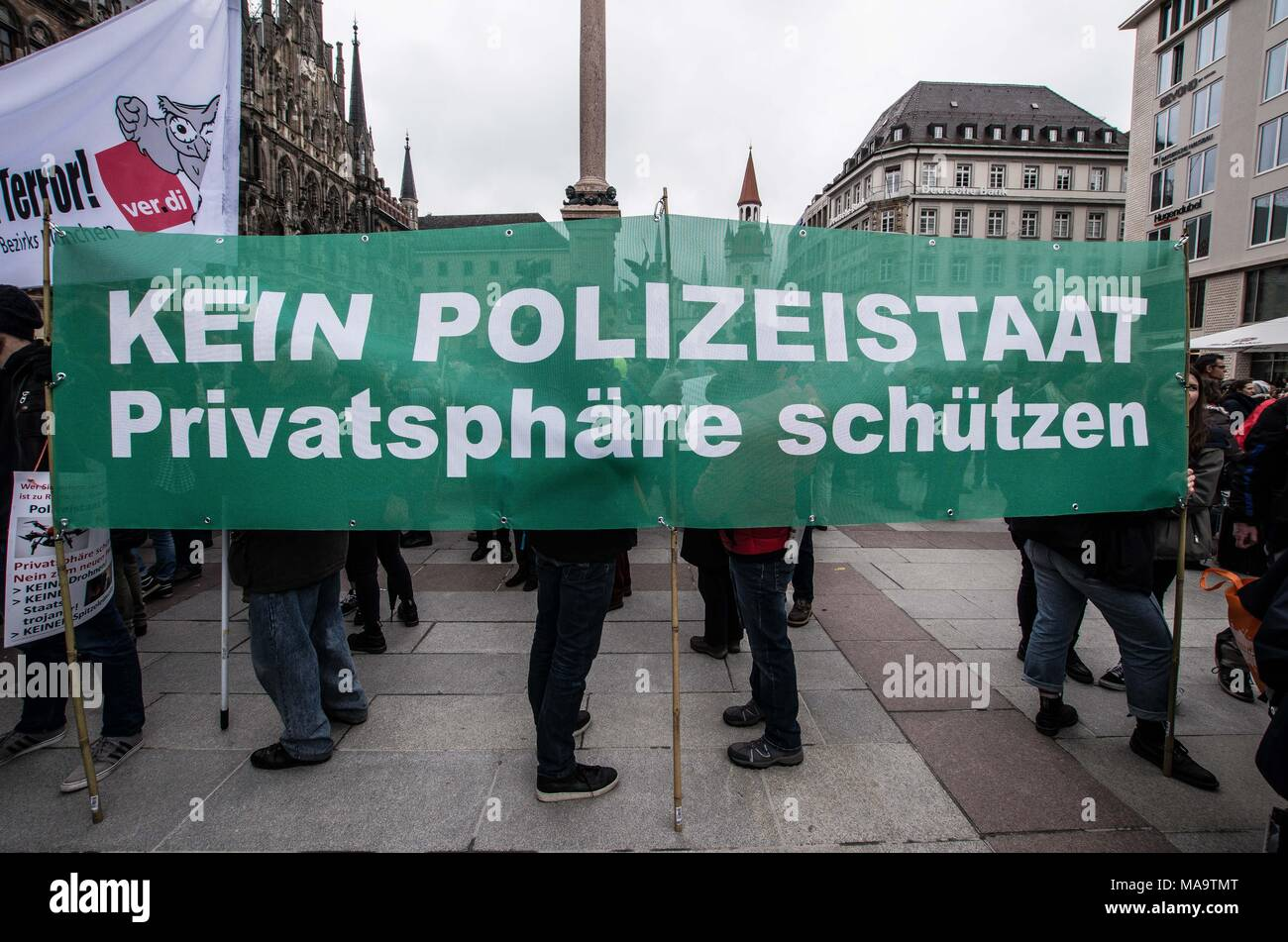 Munich, Bavaria, Germany. 31st Mar, 2018. ''No police state.protect private spheres'' referrring to the Polizeiaufgabengesetz (police assignment laws) of Bavaria, which, when ratified, will present what are called ''the toughest police laws since 1945'', giving the Bavarian police virtually unlimited power to perform surveillance and hold anyone without charges for up to three months, which can be extended to indefinitely. Critics have analyzed the laws and have stated the following: police may read paper and Email, save, delete, or freely alter said private data, they may wiretap convers - Stock Image