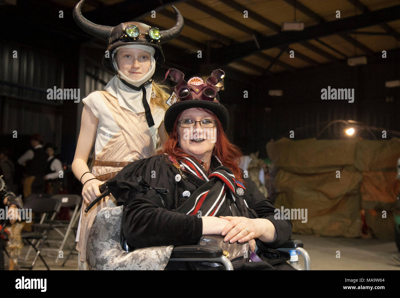 Manchester, UK 31th March 2018.  The Dawson family at the Post apocalyptic Weekend at the Asylum, the Planet's largest steampunk festival where a City becomes Wasteland Costumes Capital for four days. The Victorian Steam punk Society, teamed up with Manchester's Bowlers Exhibition Centre and the organisers of For the Love of Sci Fi to create a Cosplay Expo. Credit: MediaWorldImages/AlamyLiveNews - Stock Image