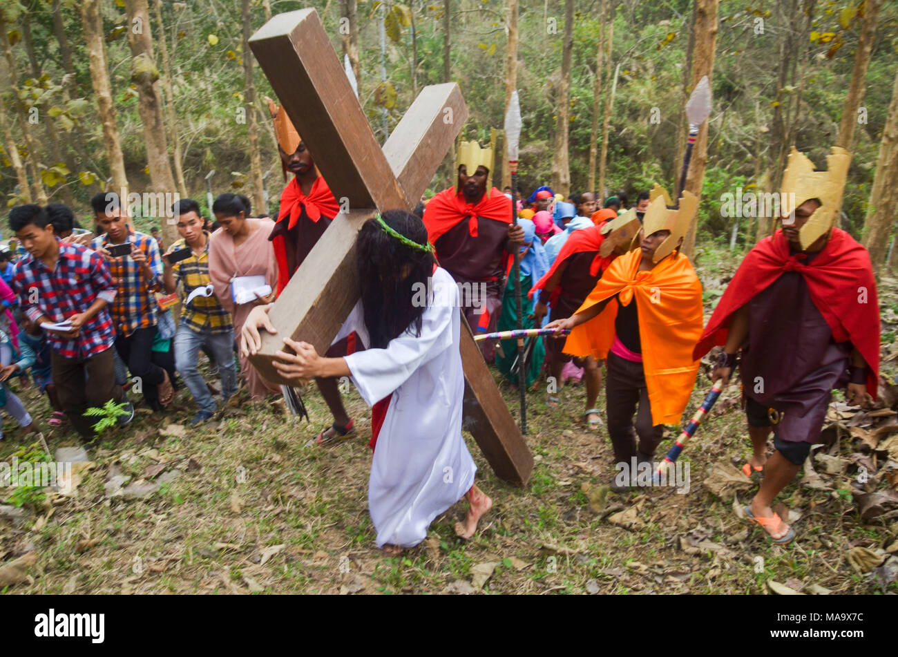 Good Friday procession, Guwahati, Assam, India. 30th March 2018. A devotee dressed as Jesus Christ re-enacts the Crucifixion during Good Friday procession in Guwahati. - Stock Image