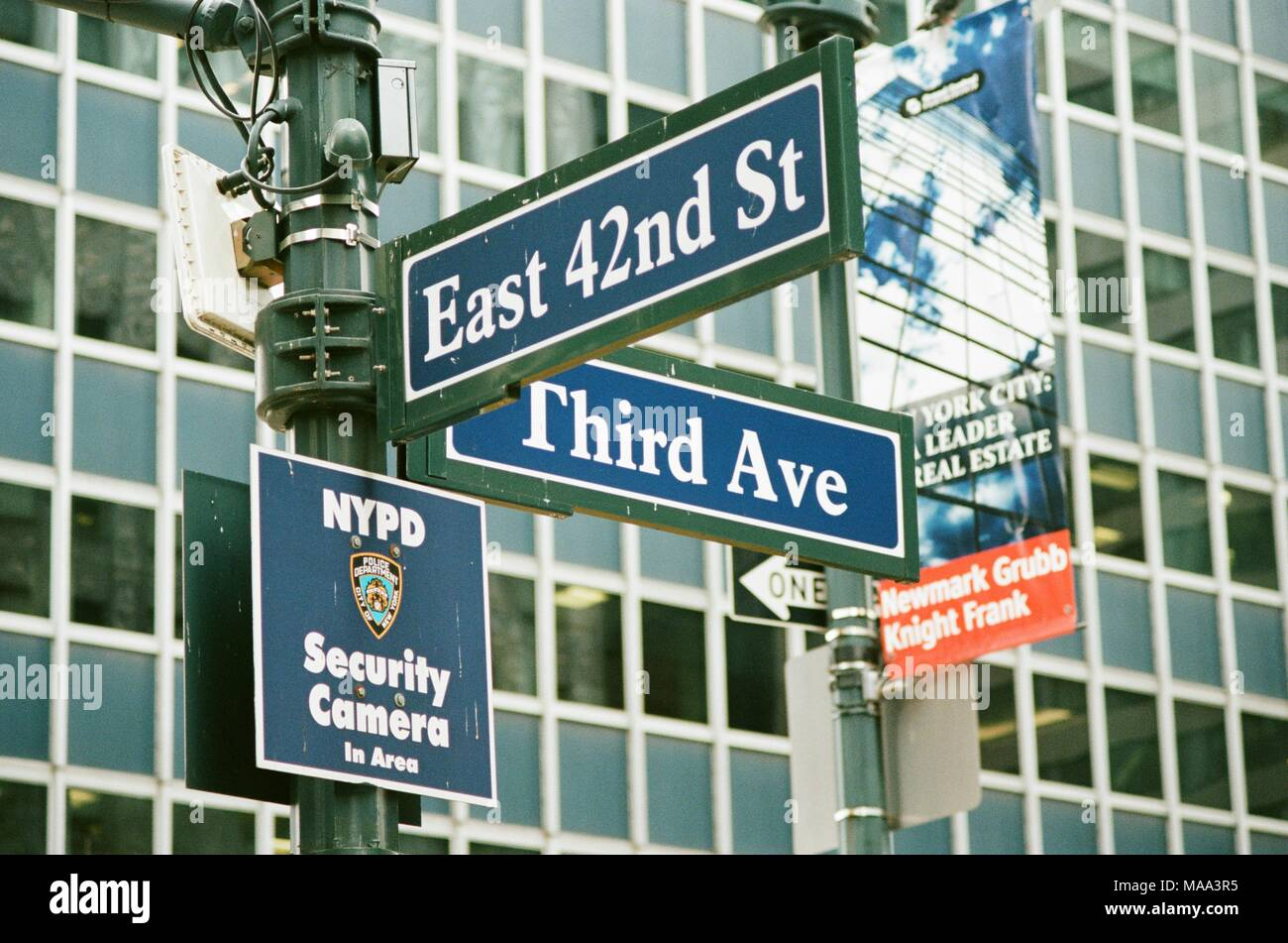 Road sign for the intersection of 42nd Street and 3rd Avenue in Manhattan, New York City, New York, with NYPD surveillance sign also visible, September 15, 2017. () - Stock Image