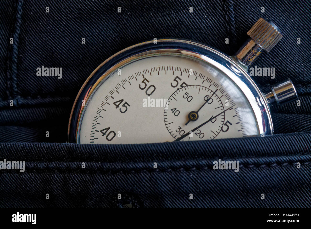 Vintage antiques Stopwatch, in new back jeans pocket, value measure time, old clock arrow minute, second accuracy timer record - Stock Image