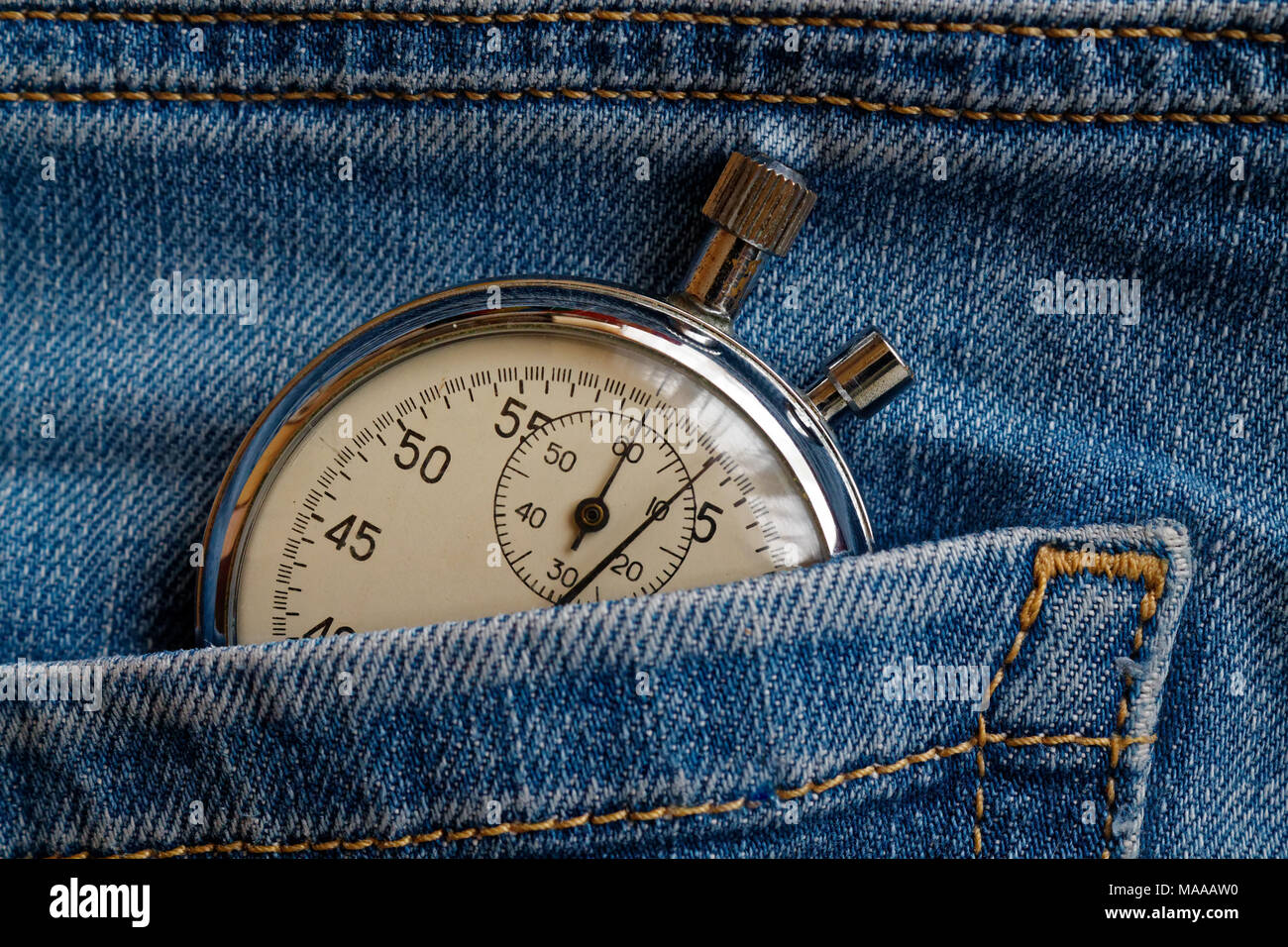 Vintage antiques Stopwatch, in worn dark blue jeans pocket