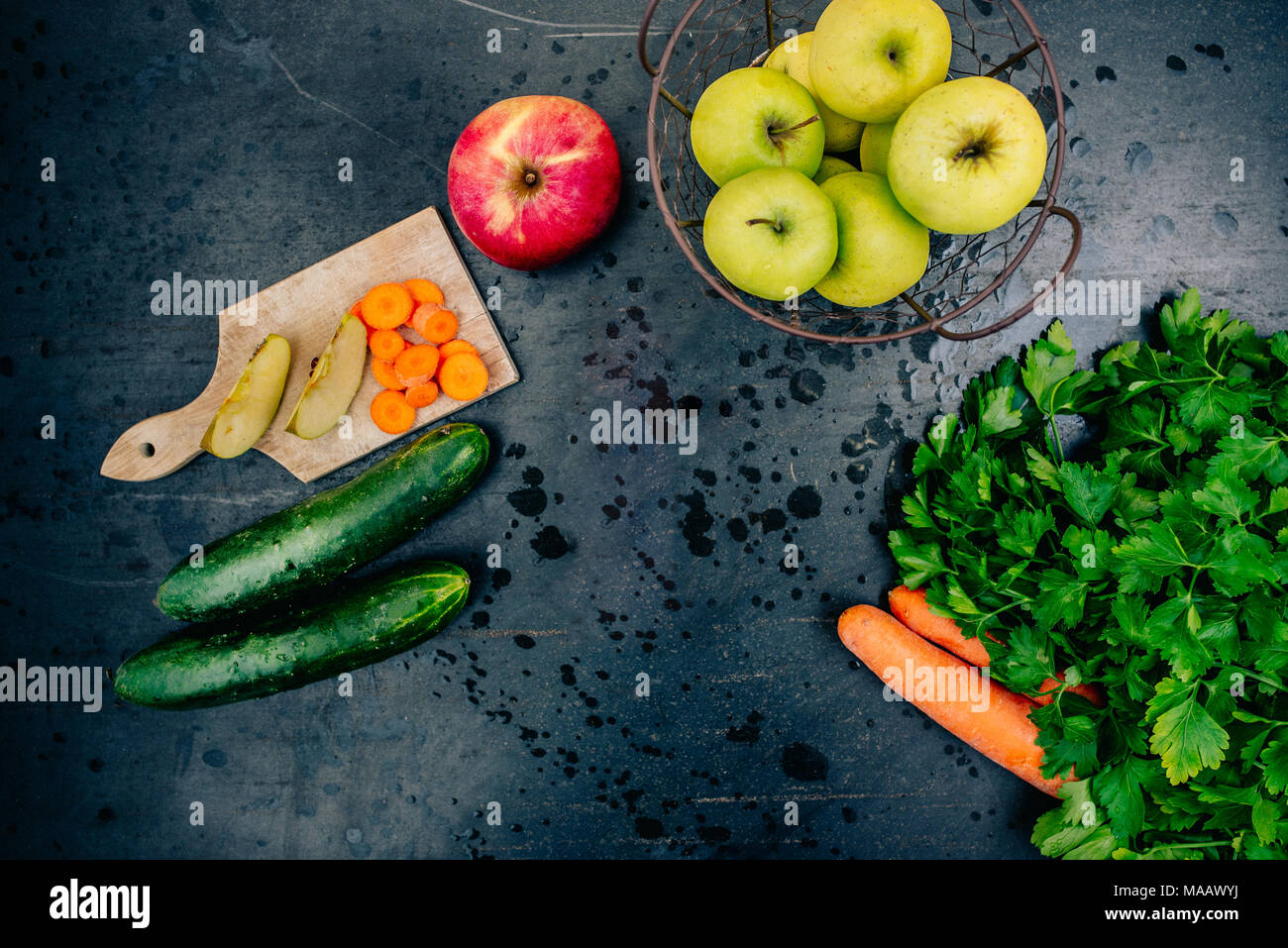Fresh fruits and vegetables on black metal surface - Stock Image