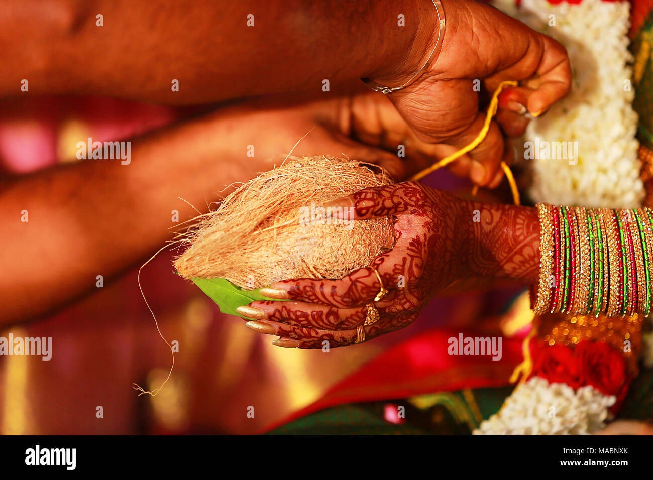 Closeup hand South Indian wedding rituals, ceremony - Stock Image