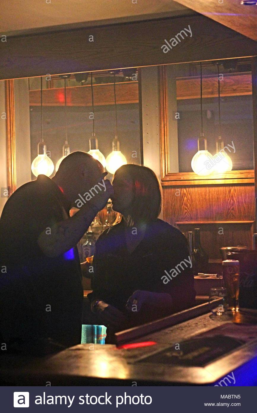 'Conversations'  - Night still of a man and woman in conversation at a bar in an Essex, UK Club. - Stock Image