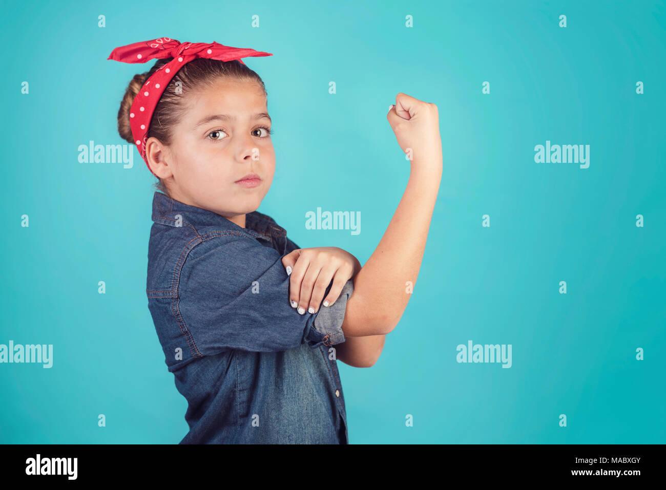 girl feminism,girl showing her muscular arm - Stock Image