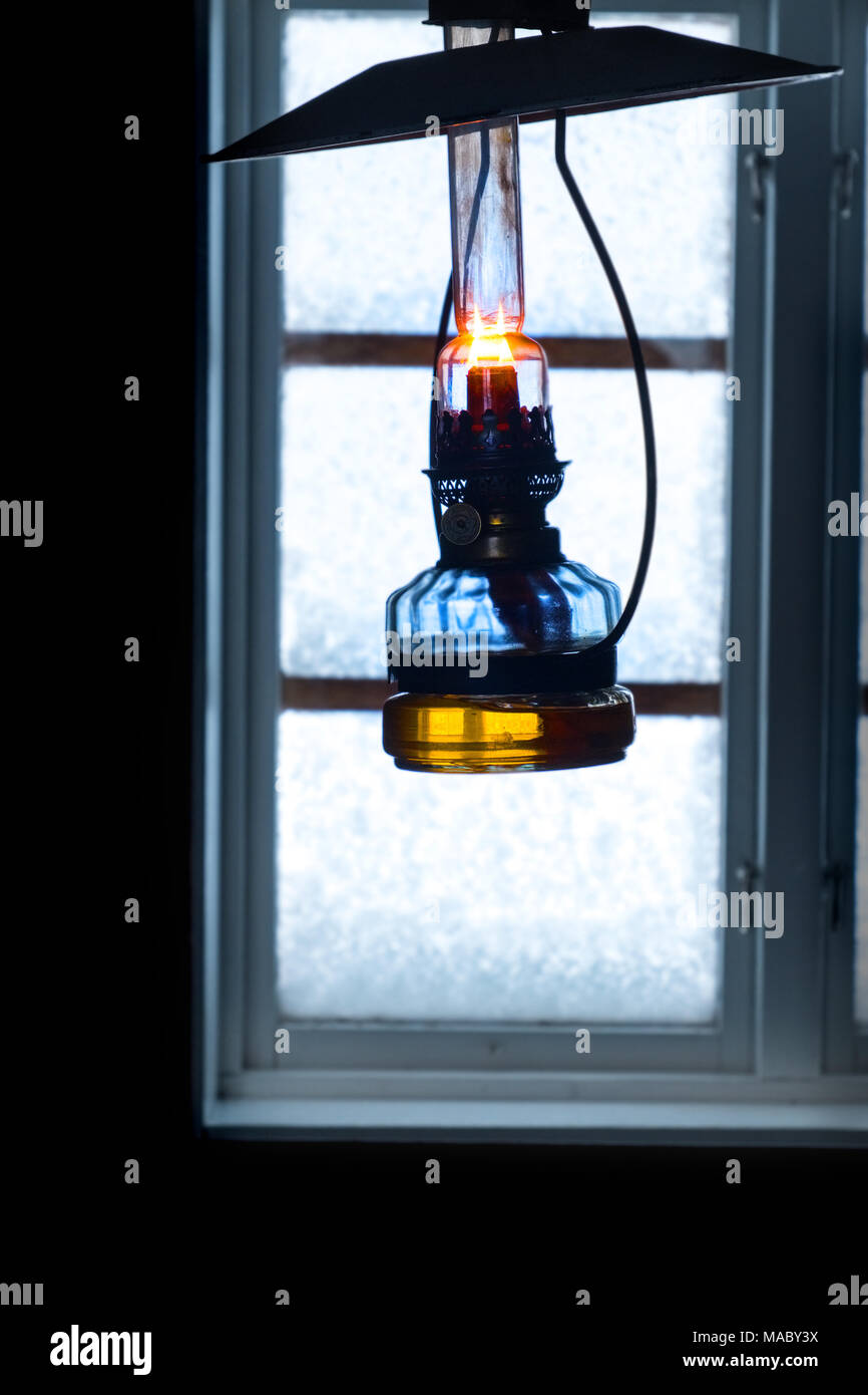 Oil lamp in a cabin - Stock Image