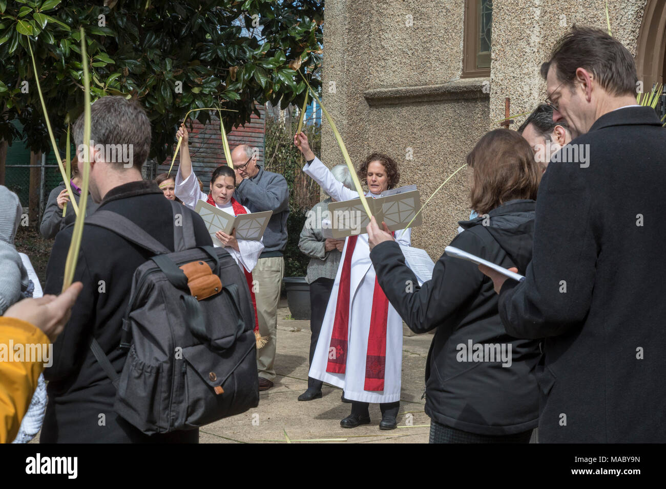 Washington, DC - Members of Christ Church celebrated Palm Sunday with a procession in their Capitol Hill neighborhood before worship at the church. Ch - Stock Image