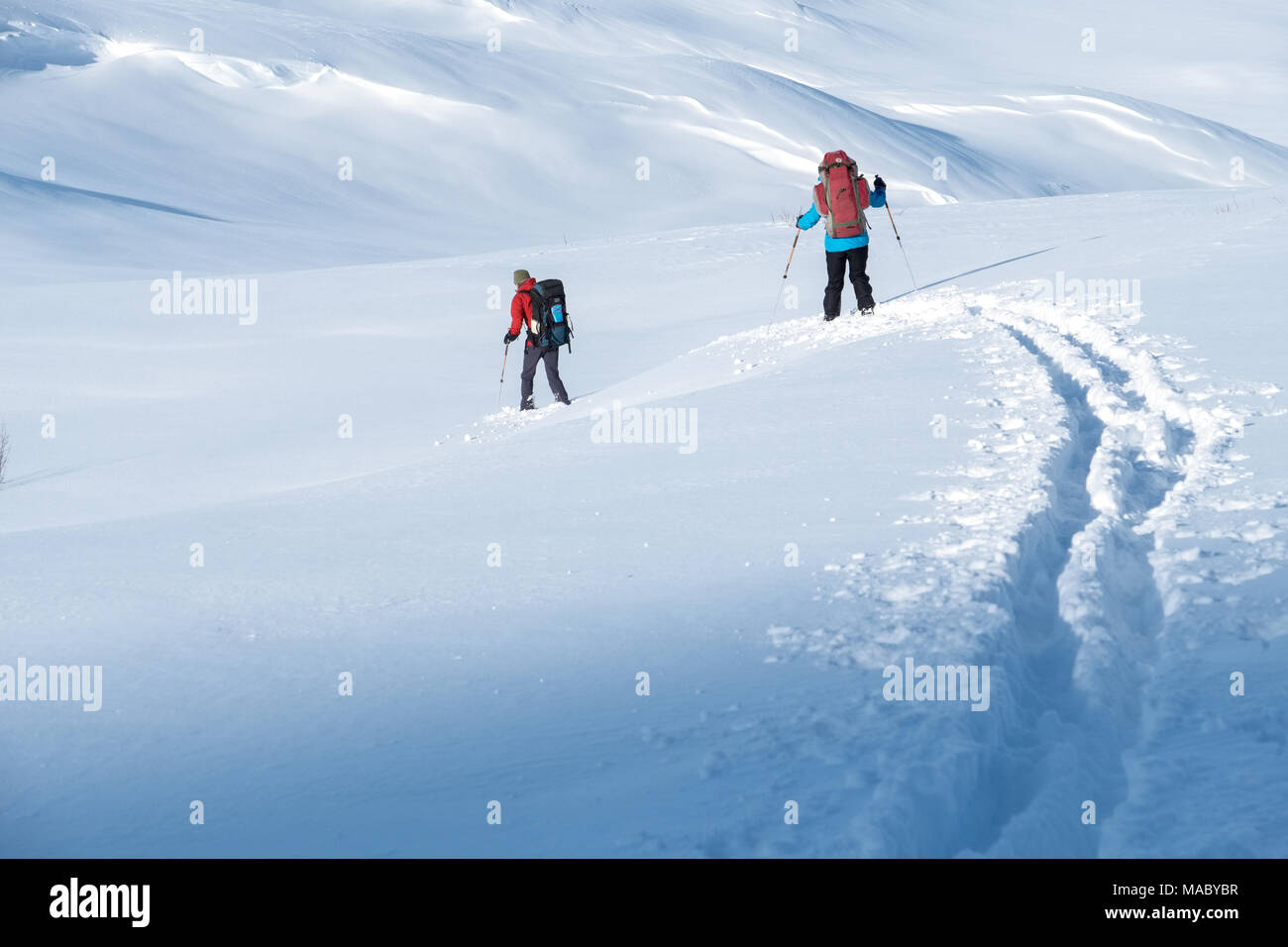 Two ski tourers / x-c skiers in northern Sweden - Stock Image