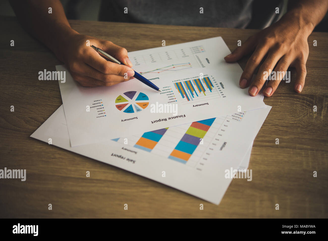 Businessman holding and analyzing investment chart working in office. Business work concept. - Stock Image
