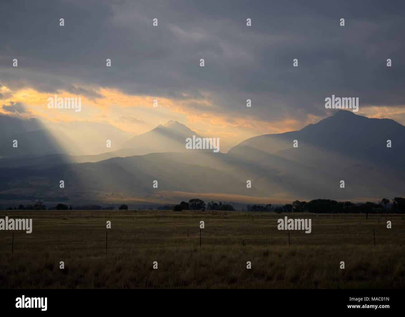 Sun Rays Through the Smoke - Stock Image