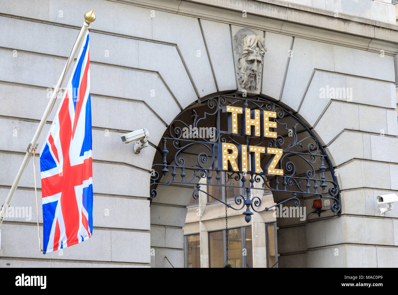 The Ritz Hotel on London's Piccadilly next to a Union Kack Flag,  The Ritz  is an iconic London brand or landmark - Stock Image