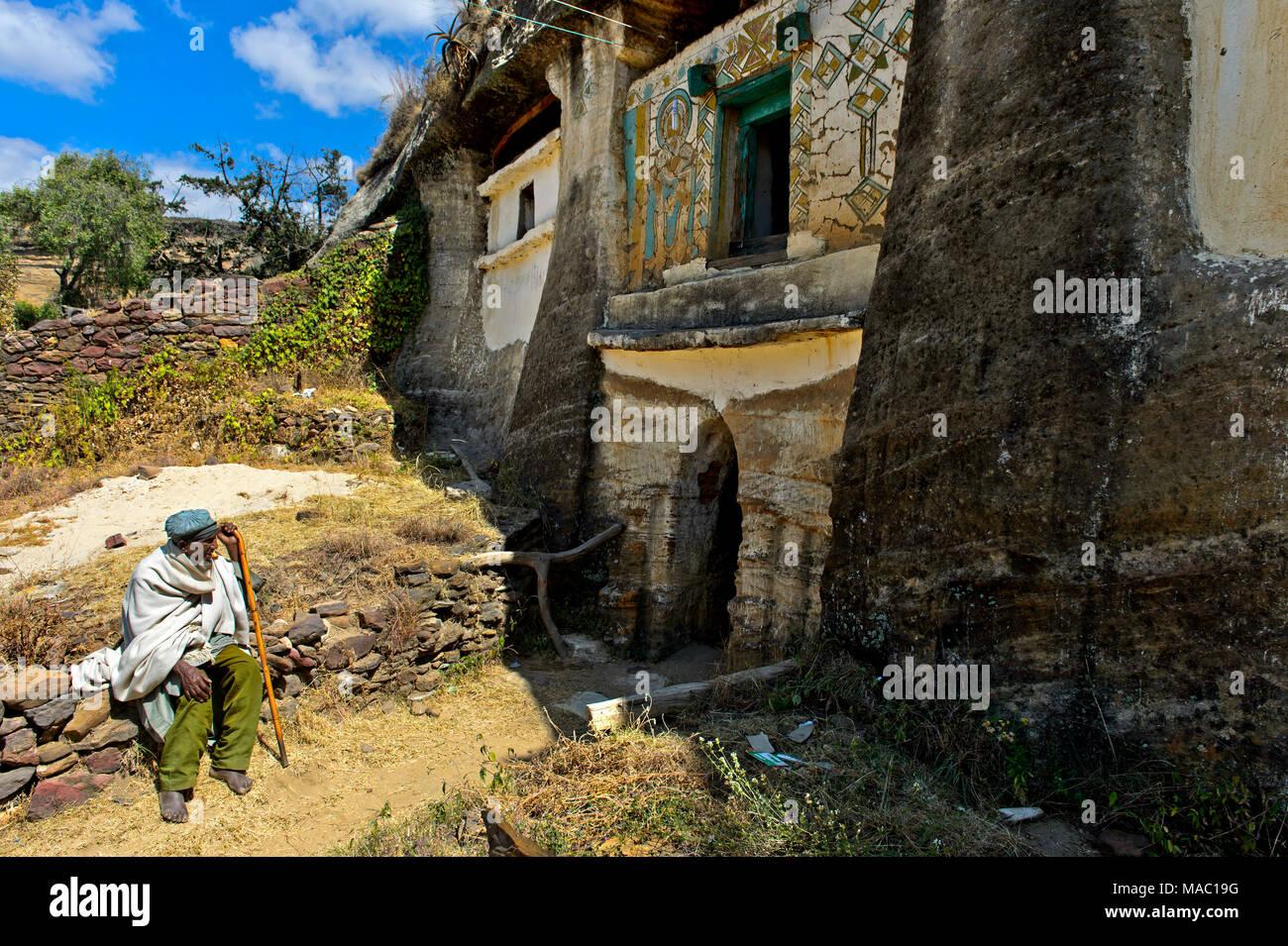 Pilgrim at the entrance  to the orthodox rock-hewn church Medhane Alem Kesho, Tigray region, Ethiopia - Stock Image