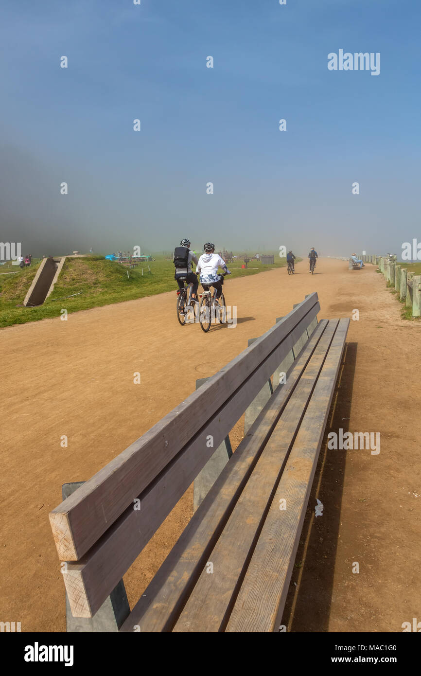 Bicyclists and park goers enjoyed a beautiful foggy morning at the Cissy Field in San Francisco, California, United States. - Stock Image