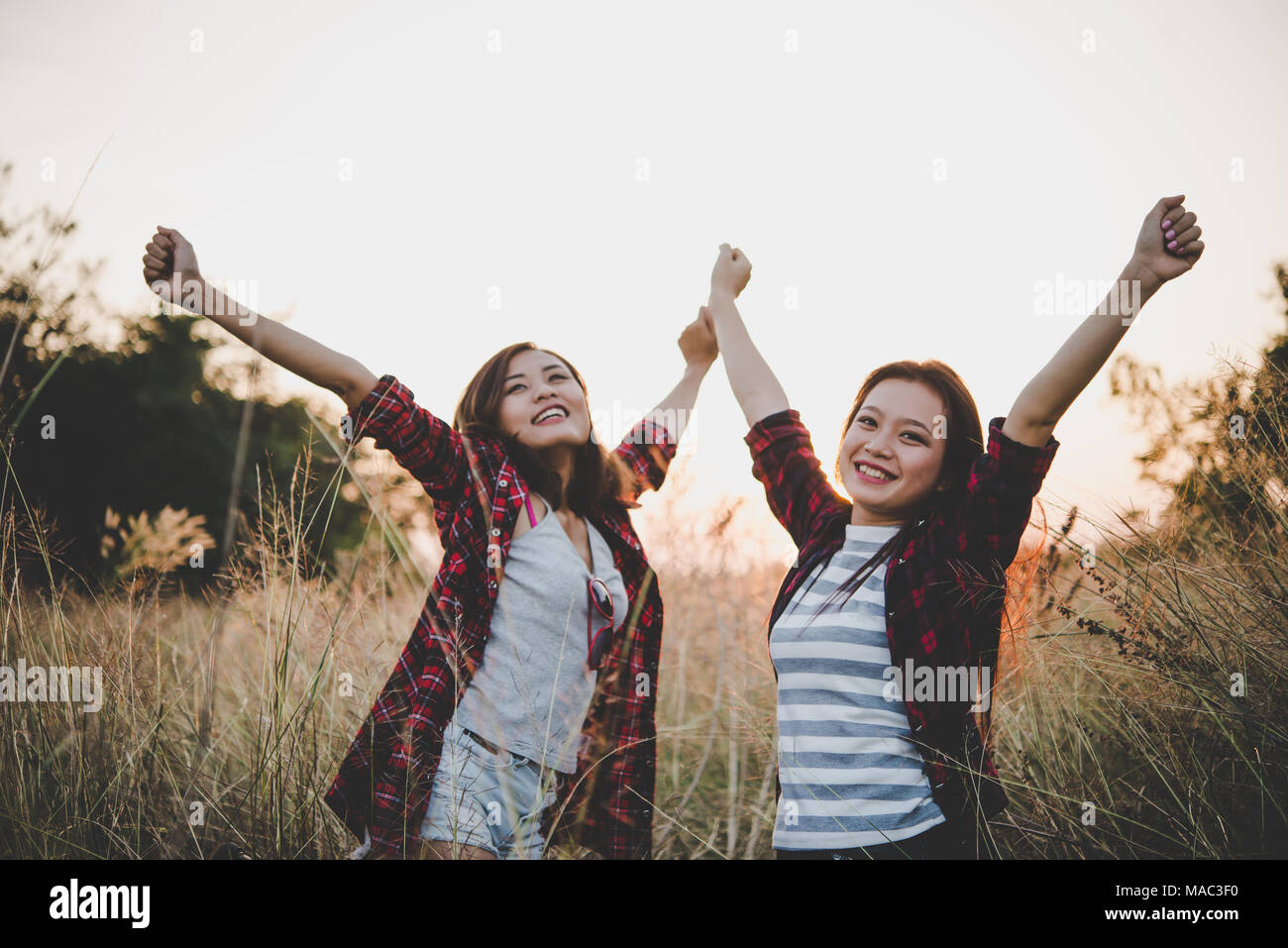 Close Up Of Two Girls Close Friends In Field With Sunset Background Freedom Enjoy Together Vintage Filter Style Happy Friendship In Field Stock Photo Alamy