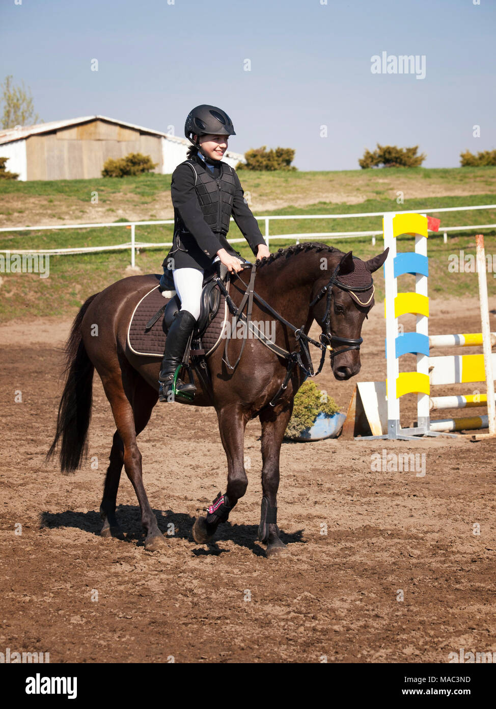 Smilling young girl happy after win the showjumping competition - Stock Image
