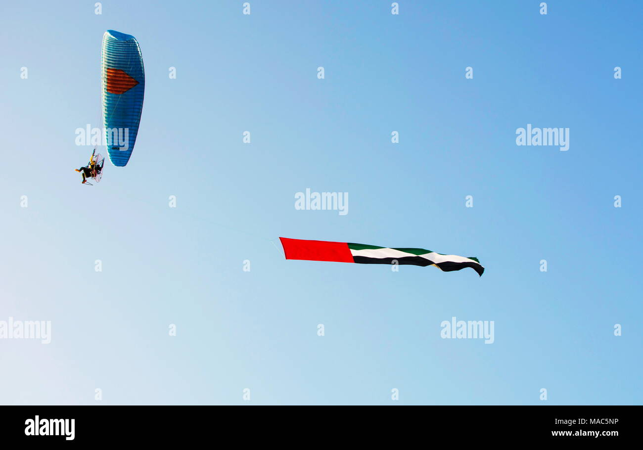 United Arab Emirates flag flying in the air from a Stock Photo