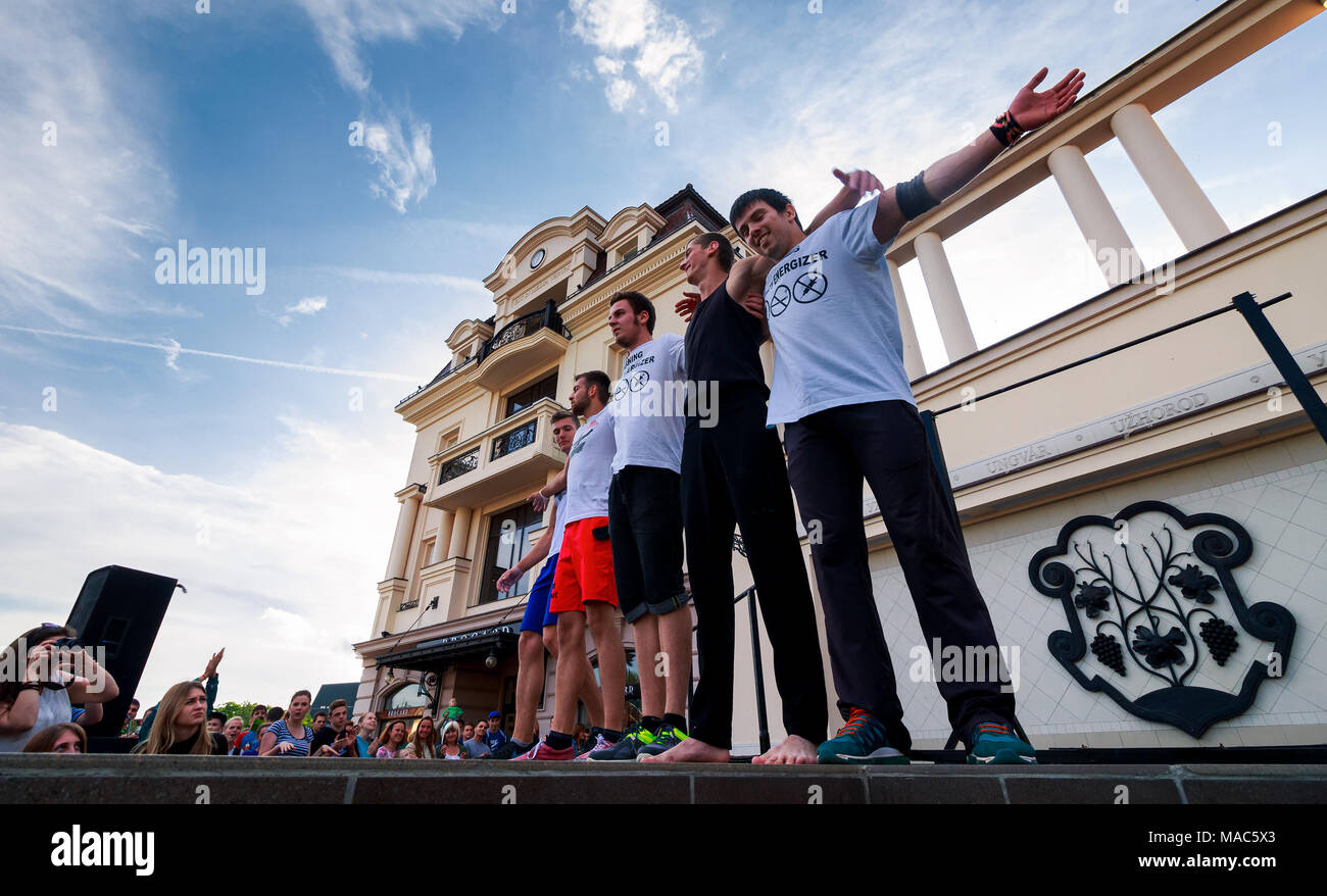 Uzhgorod, Ukraine - Jun 10, 2016: participants of outdoor sports competition. workout championship in Uzhgorod. Young men celebrate their victory Stock Photo