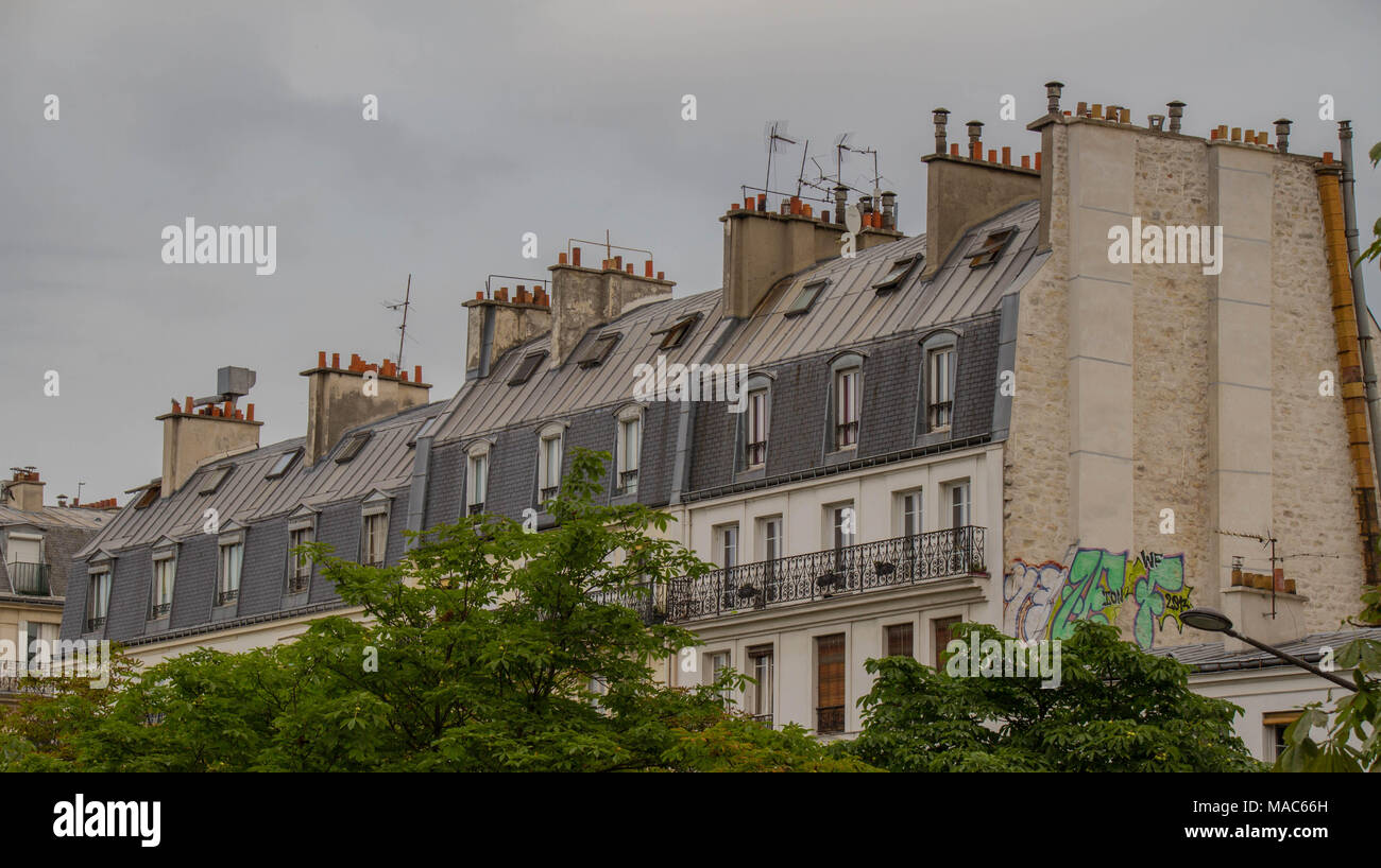 Paris, France - numerous television antennas and chimneys on the roof of an apartment building image in landscape format - Stock Image