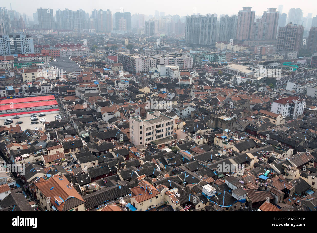 Traditional houses with modern high rises, Pudong, Shanghai, China - Stock Image