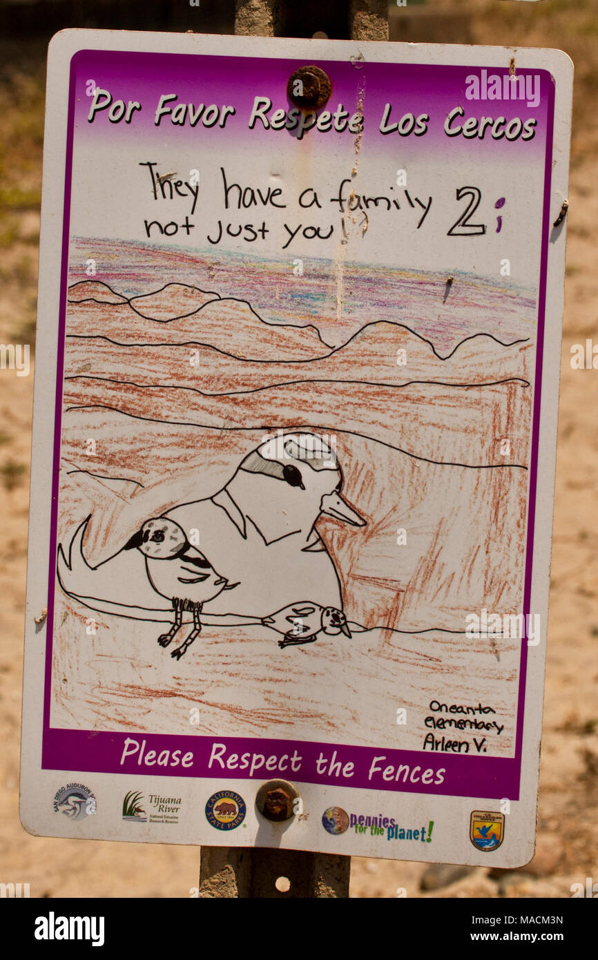Share the Shore with our snowy plovers!. The Share the Shore project in partnership with Audubon California made these wonderful signs possible to be posted on the Tijuana Slough NWR coastal dune habitat.  The original refuge boundary signs were vandalized and not respected, however these signs drawn by local students and printed by Audubon, did the job, by protecting the nesting area for California Least terns and western snowy plovers.  The signs were so well-respected and held up so well, that they were used the following year.  The Refuge hopes to do this same activity for the San Diego Ba - Stock Image