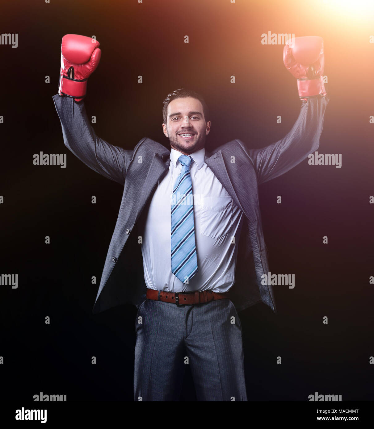 successful businessman in red Boxing gloves - Stock Image