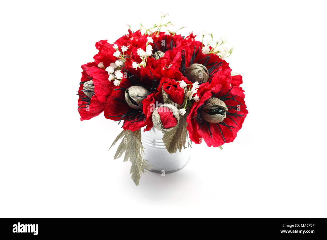 Bouquet of paper poppies handmade with candies in a galvanized metal bucket as a gift - Stock Image