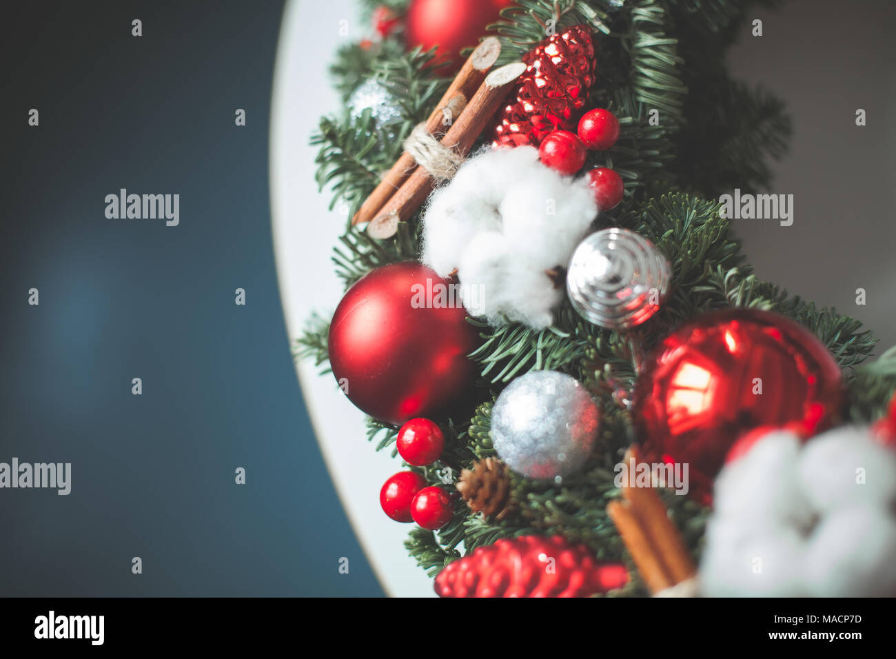 Christmas Background with Xmas Evergreen Twig, Red Glass Balls and New Year Decorations - Stock Image