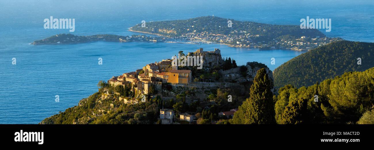 The Village of Eze (Èze), the Mediterranean Sea and Saint-Jean-Cap-Ferrat at sunrise. Alpes-Maritimes, French Riviera, Cote d'Azur, France - Stock Image