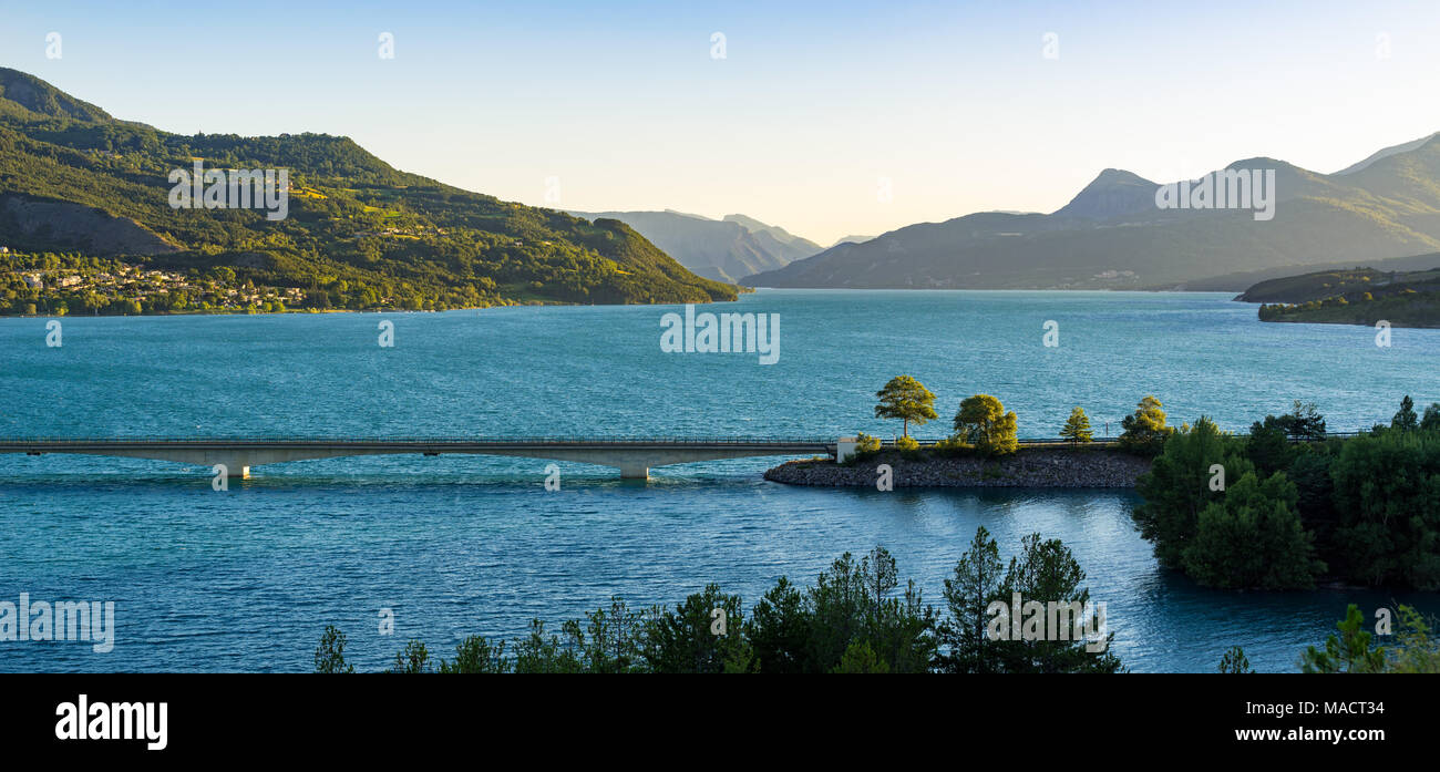 Summer panoramic view of Savines Bridge and Serre Poncon Lake in the Hautes Alpes. European Alps, France - Stock Image