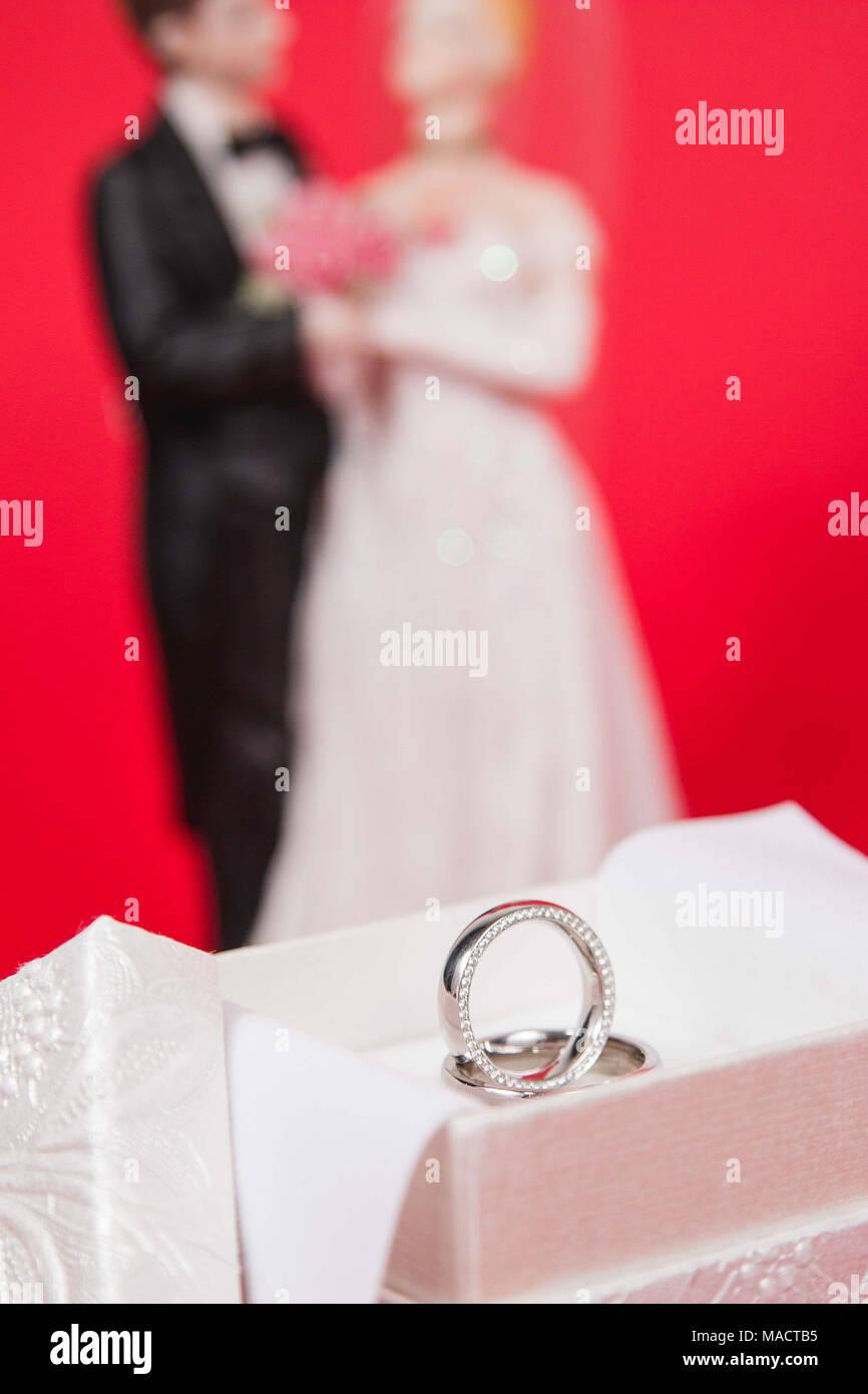 Beautiful Wedding Rings In White Luxury Box On Red Silk Stock