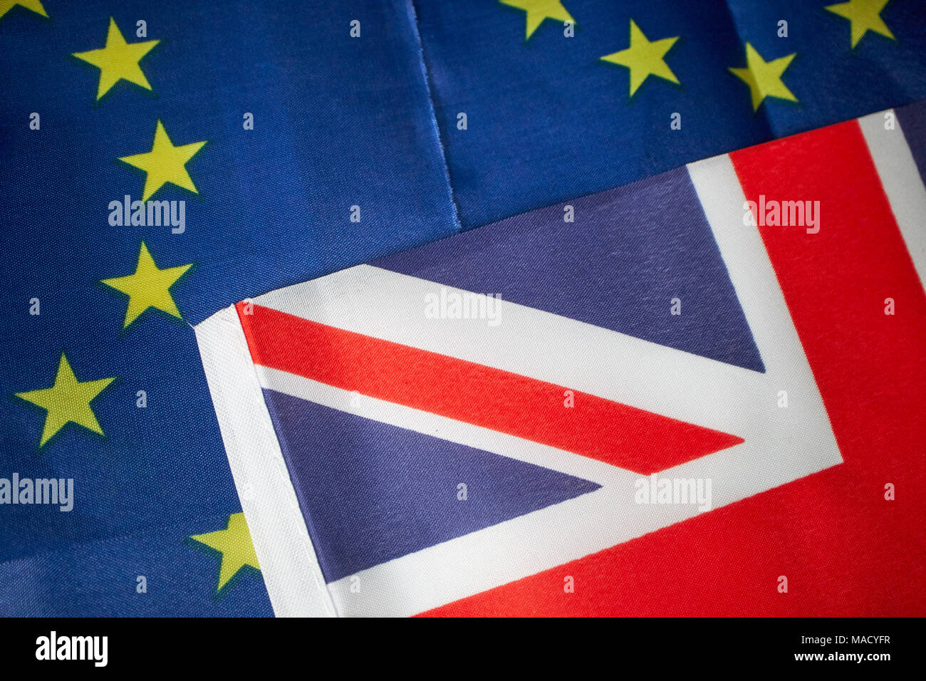 british union flag with multiple EU flags - Stock Image