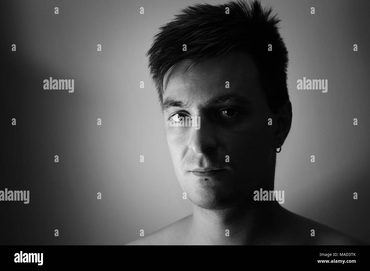 Young man contrast black and white portrait - Stock Image