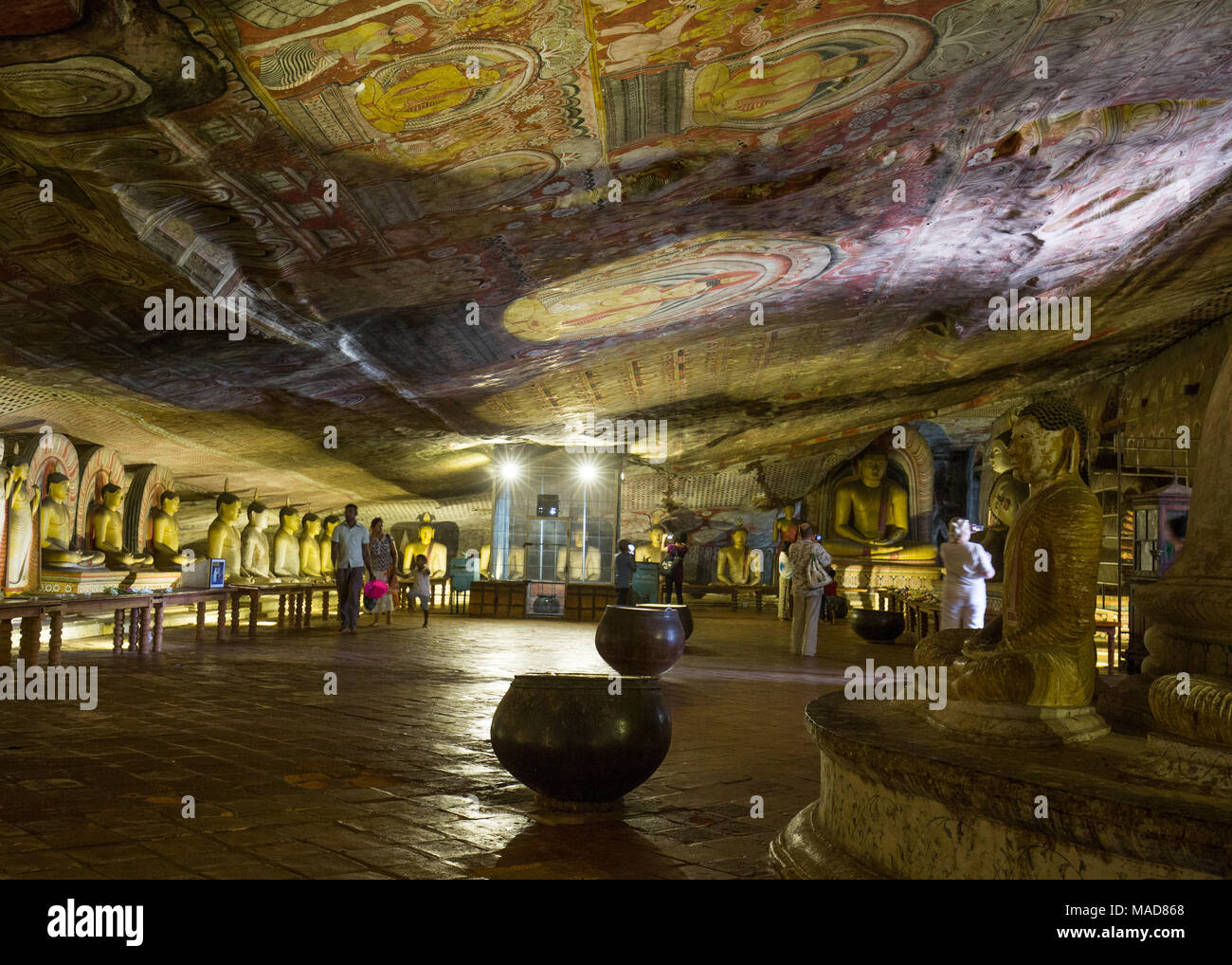 Tourists inside Dambulla Cave Temple, Dambulla, Sri Lanka, Asia. - Stock Image