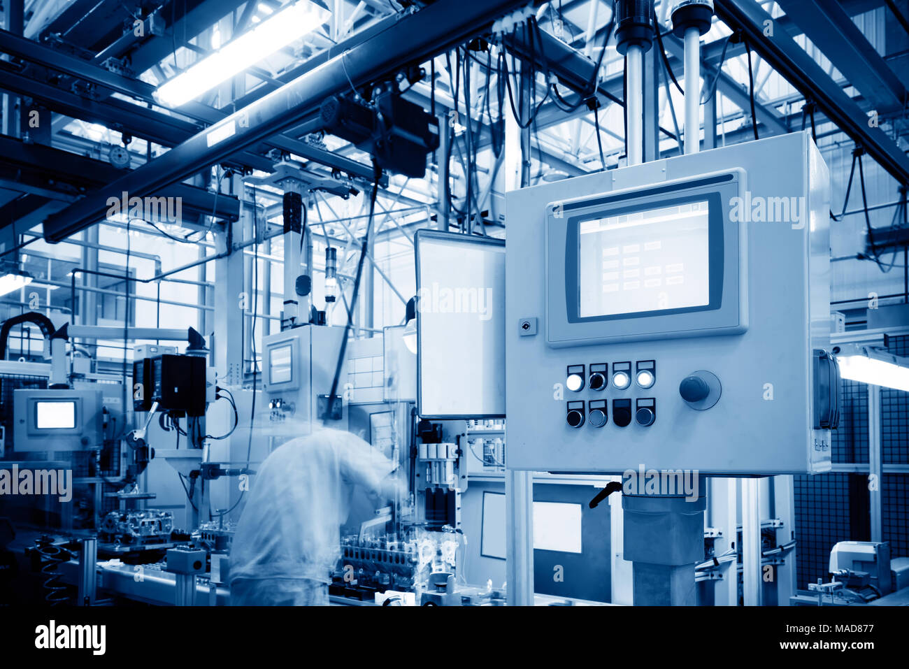 Car production line, skilled workers are working tense. - Stock Image