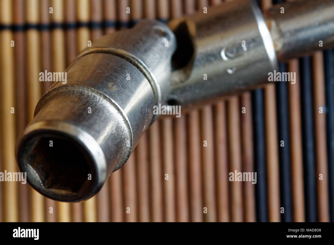 Fastener for Torx Socket for spanner on wooden background - Stock Image