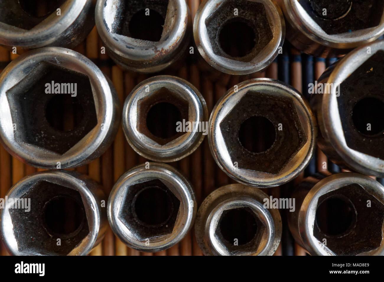 Torx Socket for spanner on wooden background, wrench sockets - Stock Image