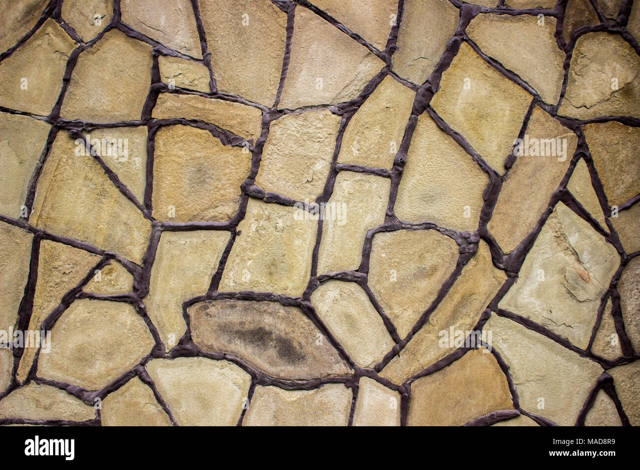 Bright and unusual stone background. Decor wall from natural sandstone. - Stock Image