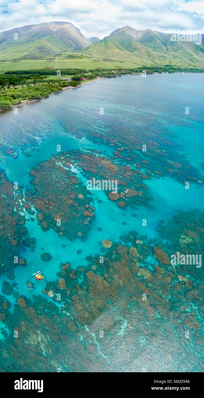 An aerial view of kayaks over the reefs off Olowalu, West Maui, Hawaii, USA. Six photographs were combined for this final image. Stock Photo