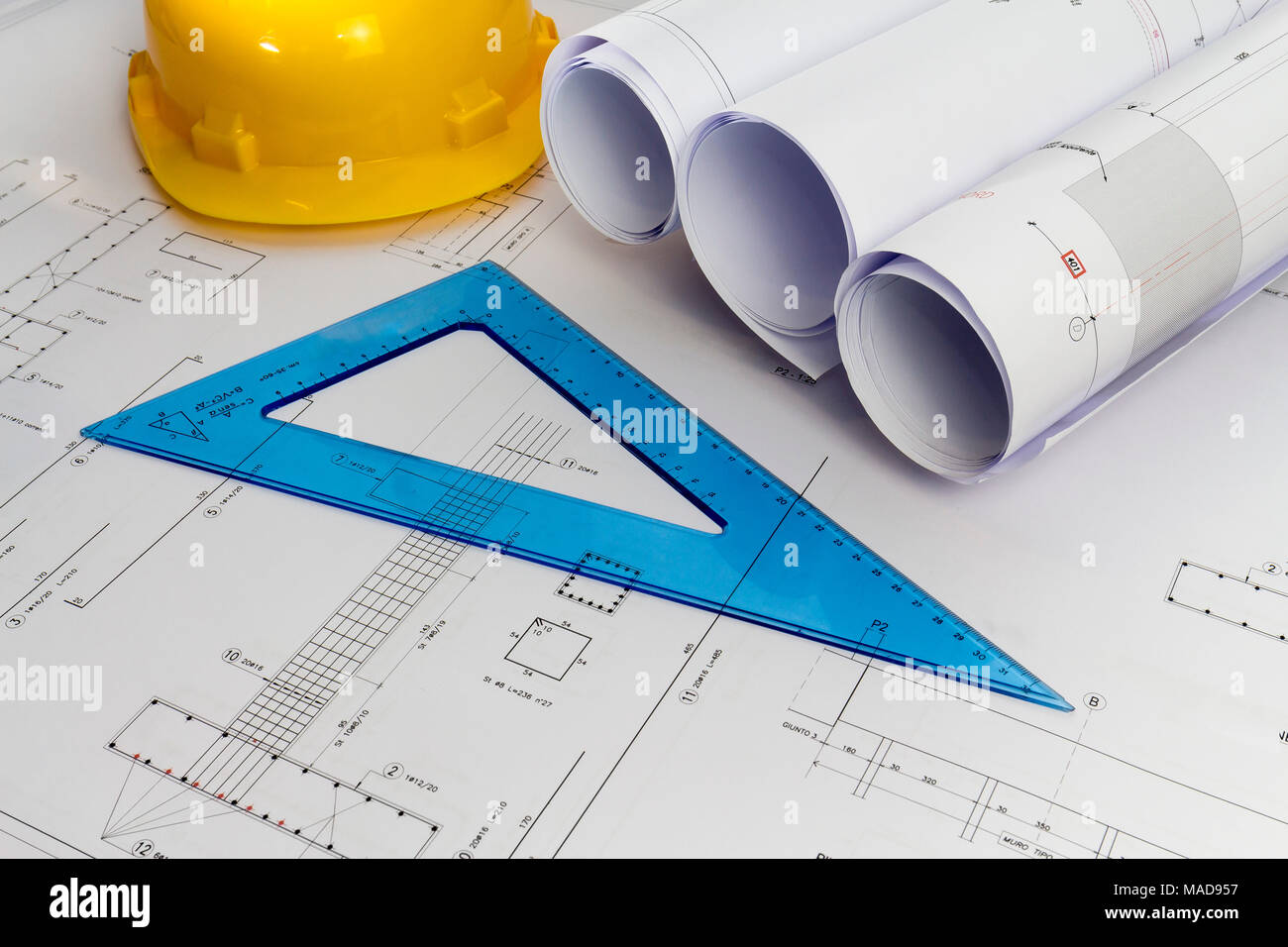 Building design: Office desk with project drawings - Stock Image