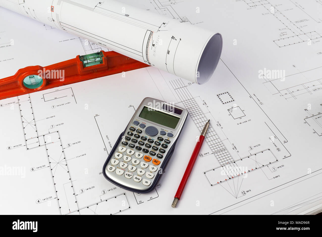 Building design: Office desk with project drawings Stock Photo ...