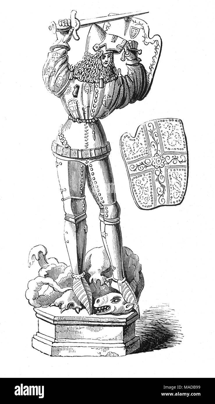 A statue of St George in Dijon Cathedral, capital of the Côte-d'Or département and of the Bourgogne-Franche-Comté region, France. Early crusaders beatified him for their successes and he became the patron saint of soldiers - Stock Image
