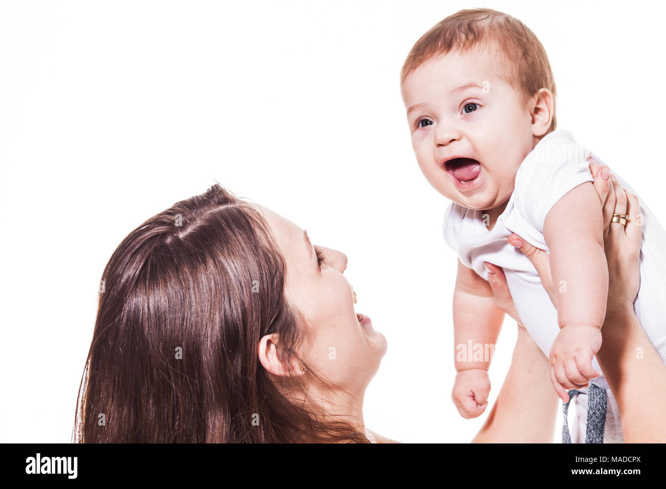 happy mother holding her baby - Stock Image